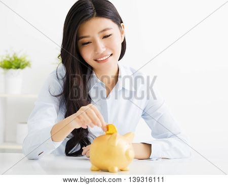 happy asian  young business woman with piggybank