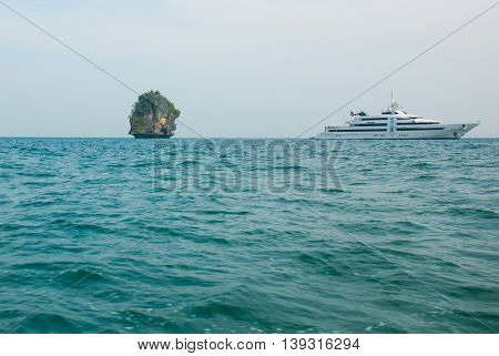 A Small Island And Tourist Ship. Krabi, Thailand.