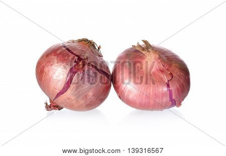 whole unpeeled red onion or shallot on white background