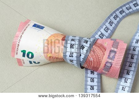 euro with measuring tape