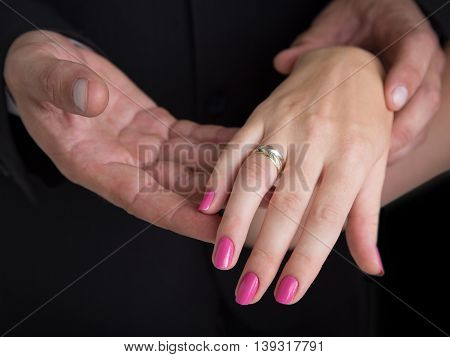 Male hand holding female hand. Male hand holding female hand.