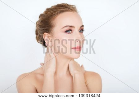 beauty, people and bodycare concept -beautiful young woman face and hands over white background