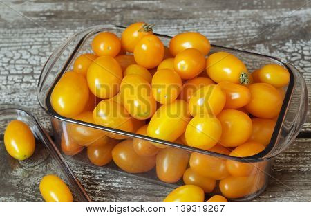 Organic Yellow Cherry Tomatoes In Plastic Container