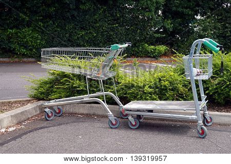 BASINGSTOKE UK - JULY 20 2016: Trolleys in the car park of the HomeBase DIY home improvement store