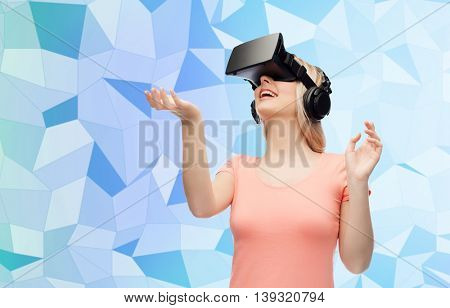 technology, virtual reality, entertainment and people concept - happy young woman with virtual reality headset or 3d glasses over blue low poly texture background