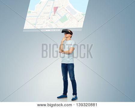 3d technology, virtual reality, entertainment, cyberspace and people concept - happy young man with virtual reality headset or 3d glasses thinking and looking at screen with gps navigator map