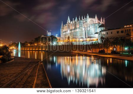 La Seu the gothic medieval cathedral of Palma de Mallorca at the night with illumination. The Cathedral of Santa Maria of Palma