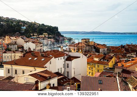 Coastal view of Piran, Slovenia. Town in Mediterranean coast. View of the historical buildings and old Church, cafes and restaurants