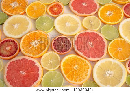 Slices Of Orange, Grapefruit, Blood Orange Lemon, Lime Arranged As A Background
