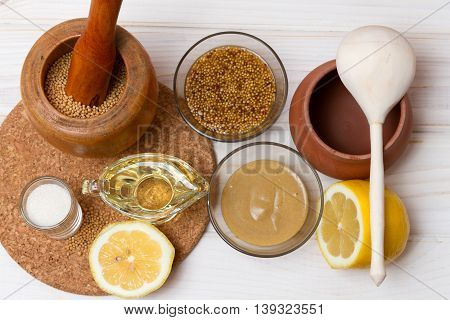 Set of ingredients and kitchen utensils for cooking homemade mustard