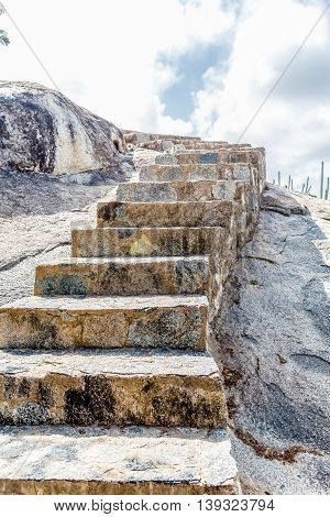 Stone steps carved into boulders in Aruba