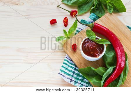Tomato Sauce Salsa, Hot Chili And Basil,  On Wooden Background
