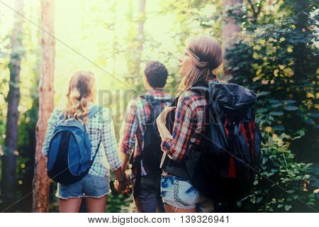 Young healty eople exploring forest as recreation