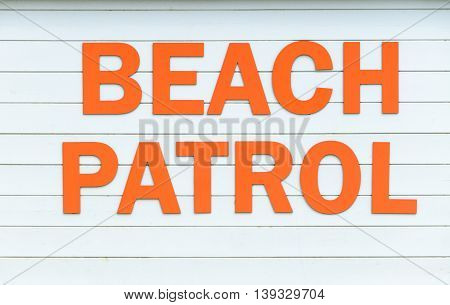 Beach patrol sign in large letters on the beach England UK.
