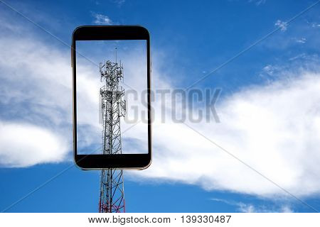 Mobile towers in display smart phone on sky and white cloud background.