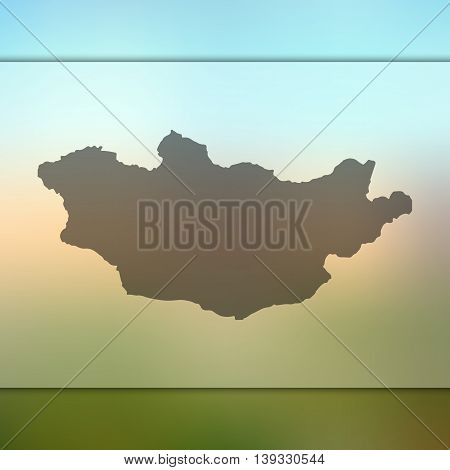 Mongolia map on blurred background. Blurred background with silhouette of Mongolia. Mongolia. Mongolia map.
