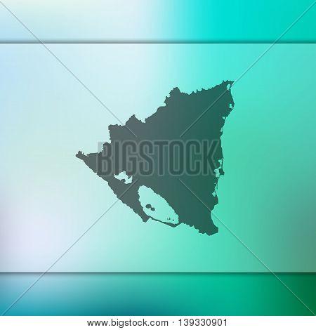 Nicaragua map on blurred background. Blurred background with silhouette of Nicaragua. Nicaragua. Nicaragua map.