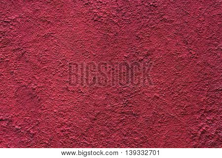 Decorative red plastered wall. Macro textured background. Pattern of plaster wall. Red wall background