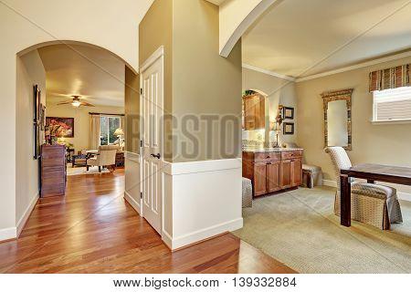 Hallway Interior With Beige Walls And Hardwood Floor
