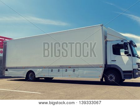 transportation, freight transport, advertisement and vehicle parts concept - truck on city parking