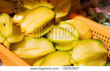 Ripe starfruit in basket at farmer's market