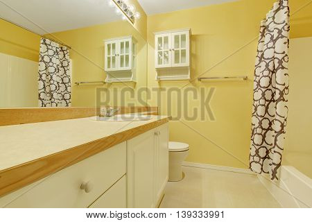 Yellow Bathroom Interior With Vanity Cabinet