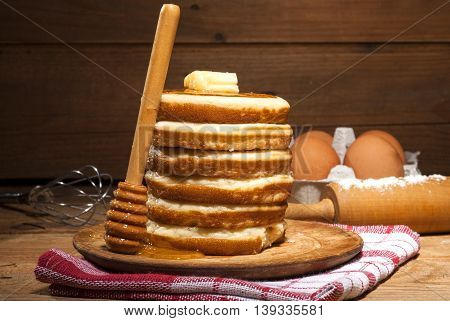 Pancakes With Honey And Butter On Wooden Background