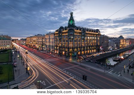 ST. PETERSBURG, RUSSIA - JUL 20, 2015: Singer building with illumination, Nevsky avenue at evening, Singer building was built in 1902-1904