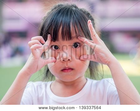 Little asian girl try to show big eyes action