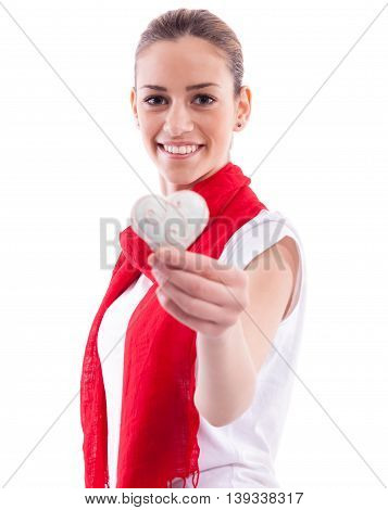 Smiling beautiful girl holding candy heart, isolated on white