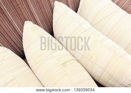 Pillows stacked on the couch forming a pattern.