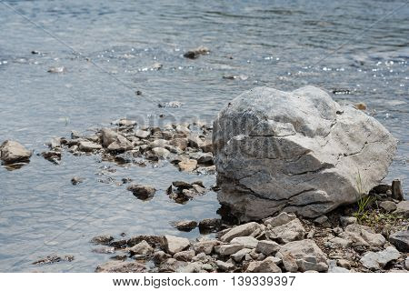 Rock lays in a running river water