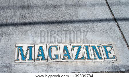 Magazine Street, marker on sidewalk in New Orleans