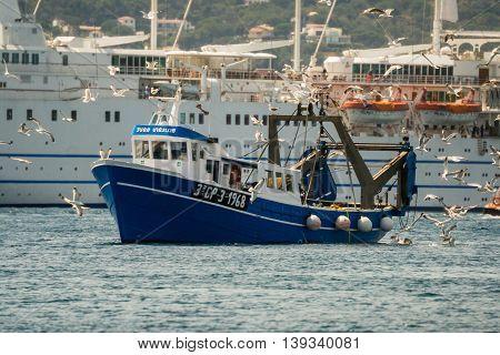 Palamos, Catalonia may 2016: Fishing motor boat fishing trawls on Mataro bay.