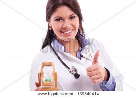 Young doctor doing job on time, isolated on white