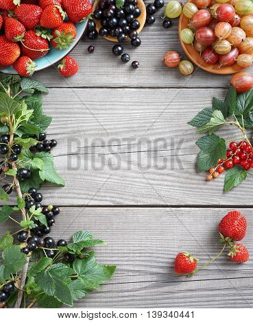 Organic food background. Photography of different berries on old wooden table. Copy space. High resolution product. Harvest concept.