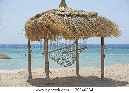 Hammock In Gazebo On A Tropical Resort Beach
