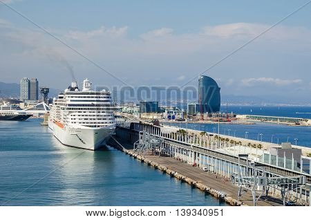 Barcelona Spain - June 2 2016: View of port Vell and its cruise terminal with two cruise-liners and W Barcelona on the right also known as the Hotel Vela (Sail Hotel).