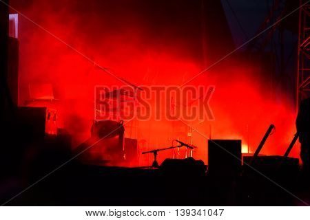 Musical instruments on the stage in red lights