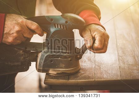 Craftsman Hands Polishing Old Color From Wooden Table