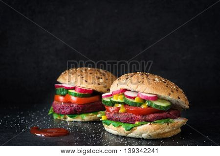 Veggie beet burger on black slate background