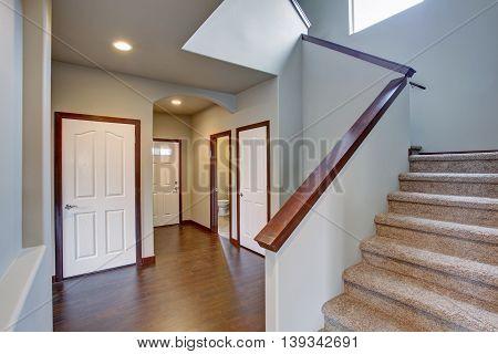 Bright Hallway In Creamy Tones With Hardwood Floor