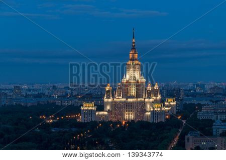 Moscow State University - one of Stalin skyscrapers at summer night in Moscow, Russia