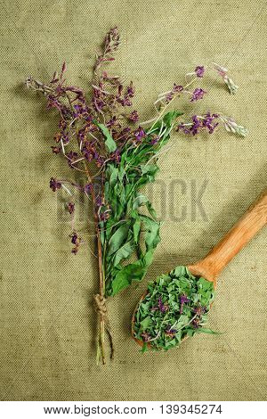 Fireweed willow-herb. Dried herbs for use in alternative medicine. Herbal medicine phytotherapy medicinal herbs. For the preparation of infusions decoctions tinctures powders ointments tea. Background green cloth