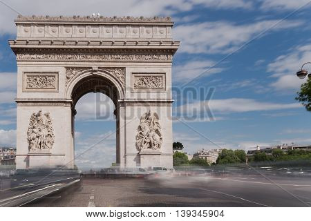 Triumphal arch. Paris. France. View of Place Charles de Gaulle. Famous touristic architecture landmark in summer day. Napoleon victory monument. Symbol of french glory. World historical heritage.