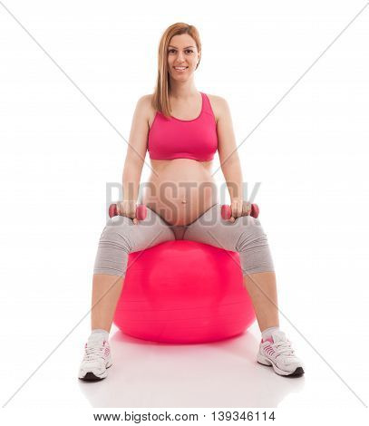 Pregnant Beautiful Woman Exercise With Ball And Dumbbells