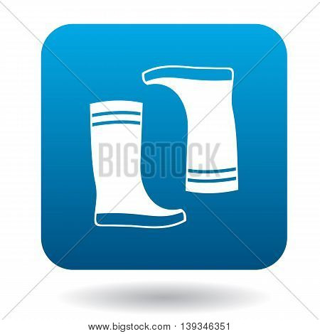 Pair of rubber boots icon in simple style on a white background