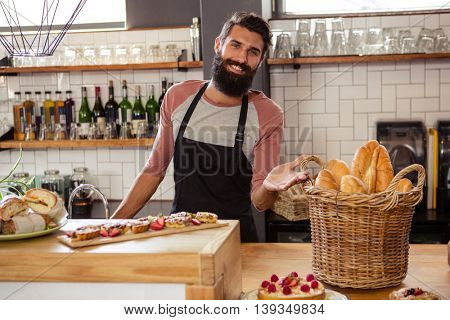 Waiter presenting food in the cafe