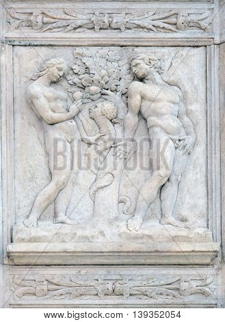 BOLOGNA, ITALY - JUNE 04: Temptation, Genesis relief on portal of Saint Petronius Basilica in Bologna, Italy, on June 04, 2015