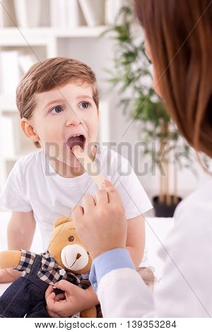 Adorable child and female doctor pediatrician, close up